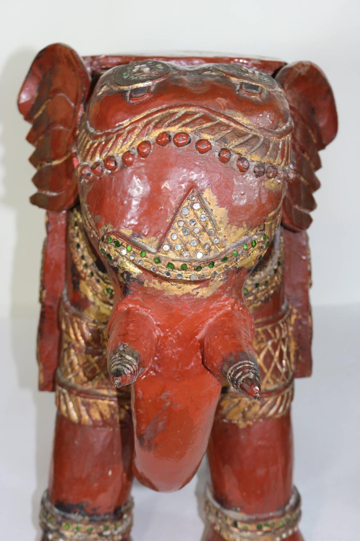 Th century dark oxblood lacquer teak wood carved