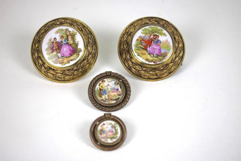 A beautiful large pair of French Fragonard signed porcelains in a highly decorative brass frame can be used for a door pull or drawer pull or drapery tie back-there is also a pair of smaller antique coordinating drawer ring pulls with Fragonard