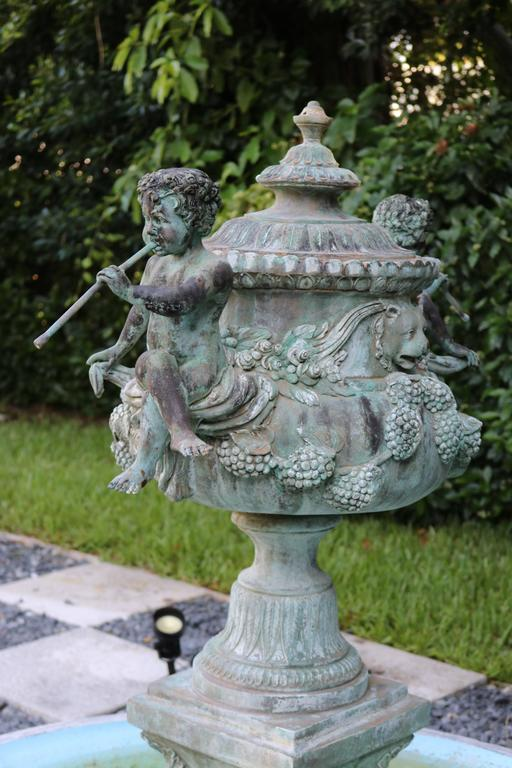 Superb Cascading Bronze Verdigris Fountain- Flute Playing Puttis- Lions-Provenan In Good Condition For Sale In West Palm Beach, FL
