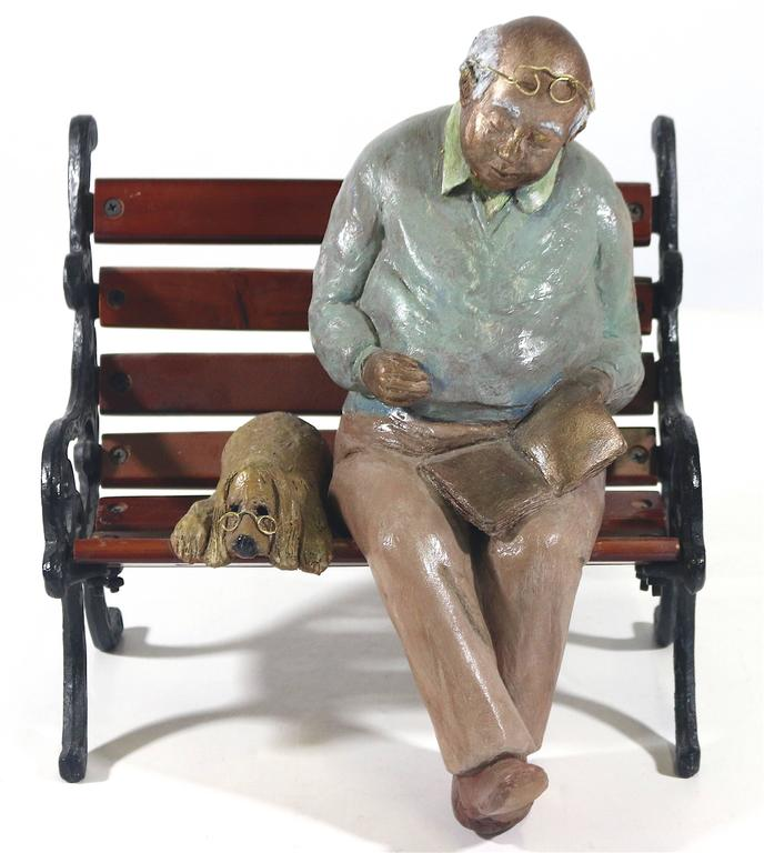 Man and his dog, what is a more poignant scene! A 20th century bit of whimsy in a charming mixed media sculpture bronze, wood, metal an Inspired image of a man of experience with his faithful wise dog and his favorite book taking a respite on a