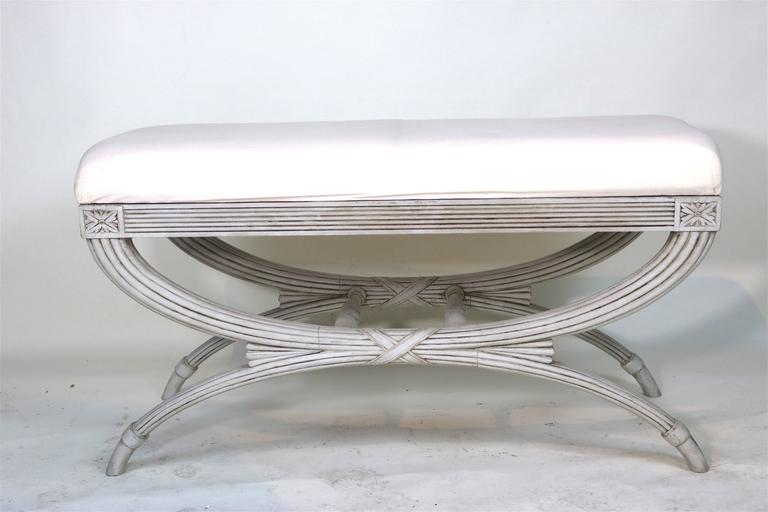 Beautiful 19th century Swedish Gustavian carved wood bench with lovely carved classical details and a graceful fluted Curule base joined by a center carved 'X' ribbon. Beautiful aged patina and condition which is desirable. Seat covered in muslin