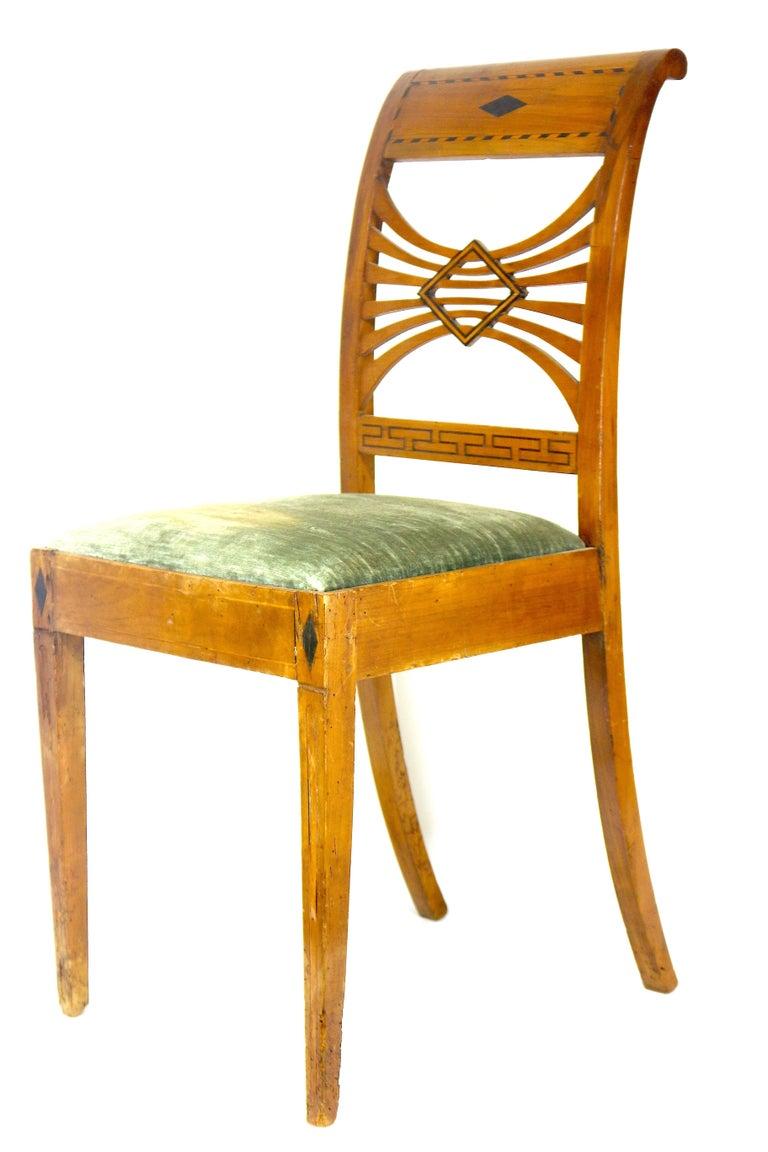 Remarkable pair of Swedish Biedermeier Karl Johan period highly detailed Birchwood side chairs. Featuring tapered legs, inspired multi-curvilinear back slats with diamond shape ebony, ebony diamond on back rail and seat apron, ebony Greek key lower