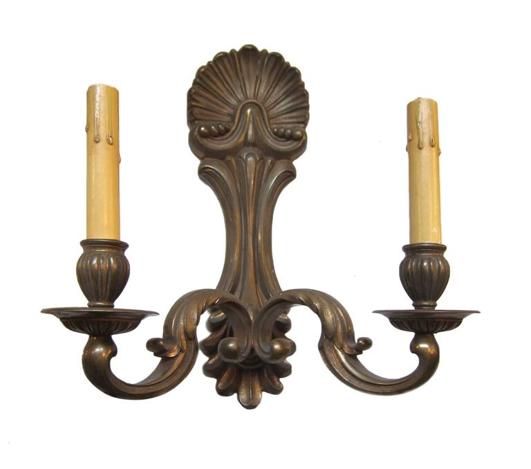1920s pair of bronze two-arm sconces. Priced as a pair. These can be viewed at our 5 East 16th Street location in Manhattan.
