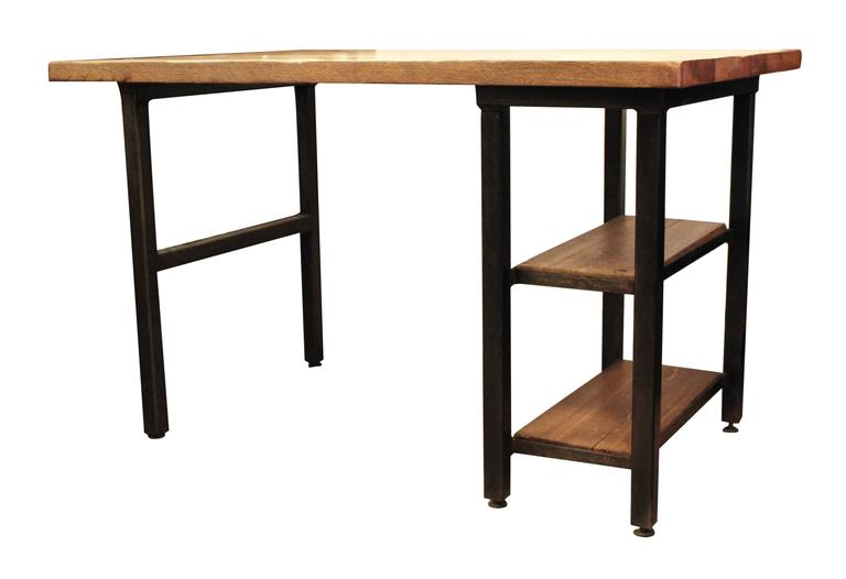 Reclaimed oakwood top desk with newly made steel legs and two shelves. Any custom sizes can be made. Please allow 8-9 weeks lead time for manufacturing. Please note since each table is custom built each table varies slightly due to the natural grain