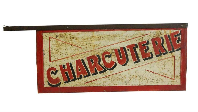 1970s distressed French white and red double-sided charcuterie metal sign. Delicatessen in French. Shows wear from age and use. This can be seen at our 302 Bowery location in Manhattan.