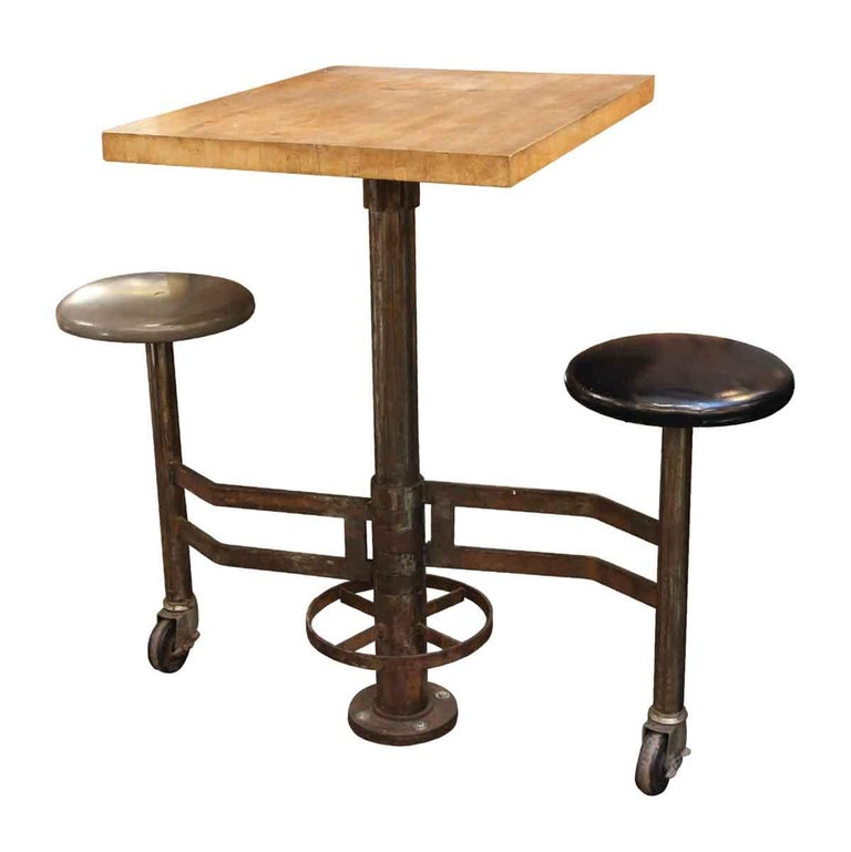 1980s Industrial Wall Mounted Counter Height Table with Attached Rolling Stools For Sale