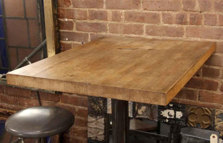 1980s Industrial Wall Mounted Counter Height Table with Attached Rolling Stools In Good Condition For Sale In New York, NY