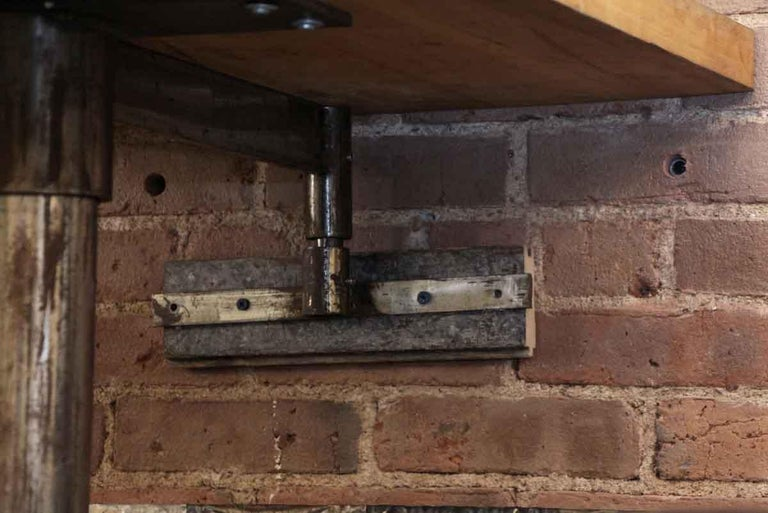 1980s Industrial Wall Mounted Counter Height Table with Attached Rolling Stools For Sale 4