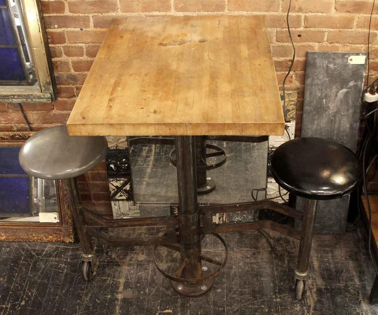 American 1980s Industrial Wall Mounted Counter Height Table with Attached Rolling Stools For Sale