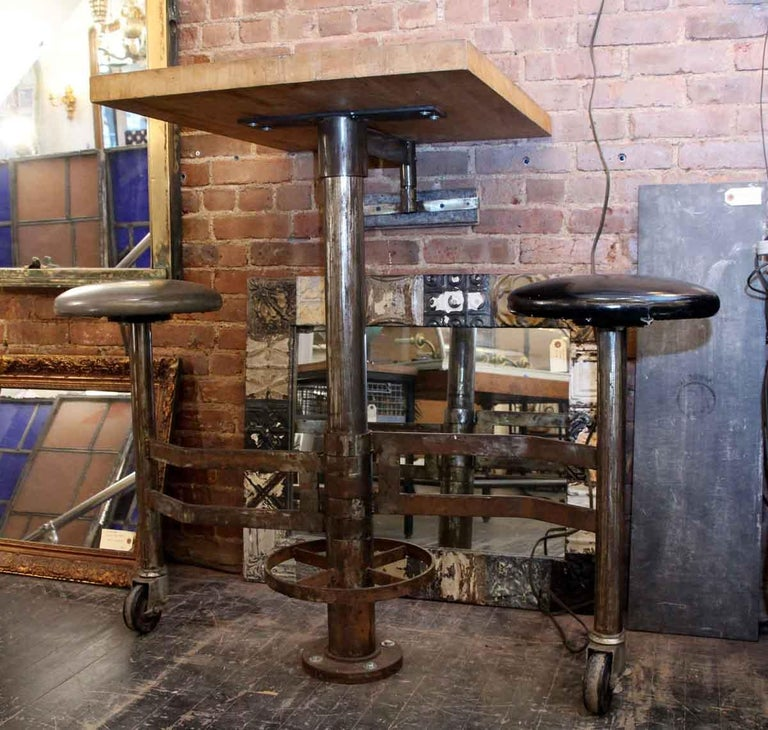 1980s Industrial Wall Mounted Counter Height Table with Attached Rolling Stools For Sale 3