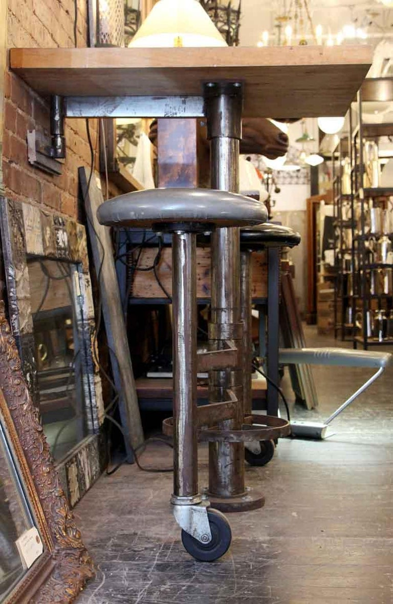 1980s Industrial Wall Mounted Counter Height Table with Attached Rolling Stools For Sale 5