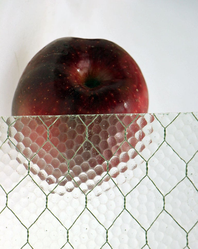 One piece 14 7/8 x 40 3/8  1920s 'Pebbled' vintage chicken wire glass. All of our chicken wire glass is salvaged from old factory windows and doors. Sizes may be limited. Chicken wire glass comes in a variety of textures: 'clear', 'pebbled',
