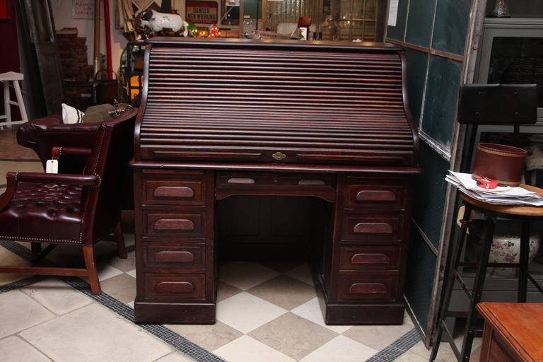 1910s petite antique wooden serpentine roll top desk with nine drawers.  This antique desk is - 1910s Petite Antique Wooden Serpentine Roll Top Desk With Nine