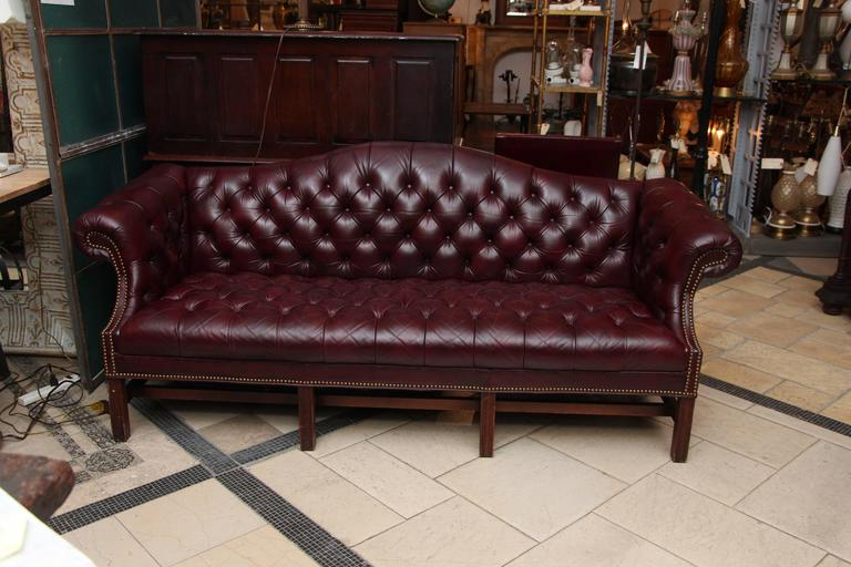 1980s tufted burgundy Chesterfield leather sofa and chair set with hickory wood manufactured by Hickory Leather Company. This set can be viewed at our 5 East 16th St, Union Square location in Manhattan.