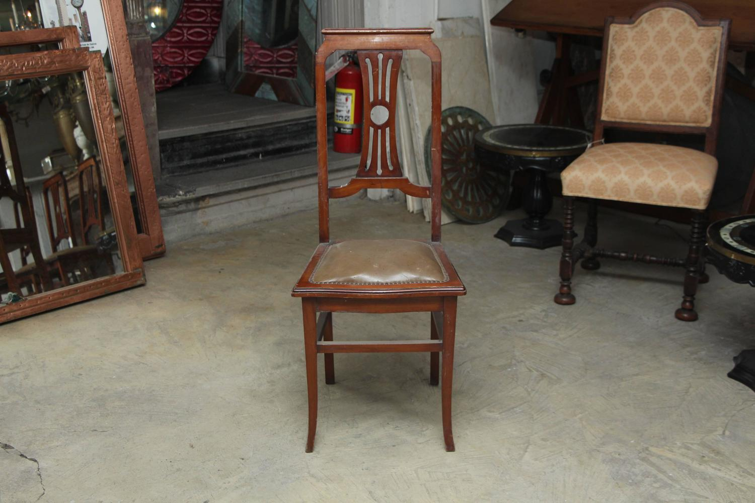 Amazing photo of  Back Carved Wood Dining Chairs with Leather Seat For Sale at 1stdibs with #653E2C color and 1500x1000 pixels