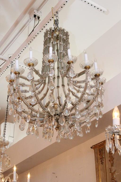Stunning 1940s crystal chandelier with 16 lights in the Marie Therese style. This item can be viewed at our 302 Bowery location in Manhattan.
