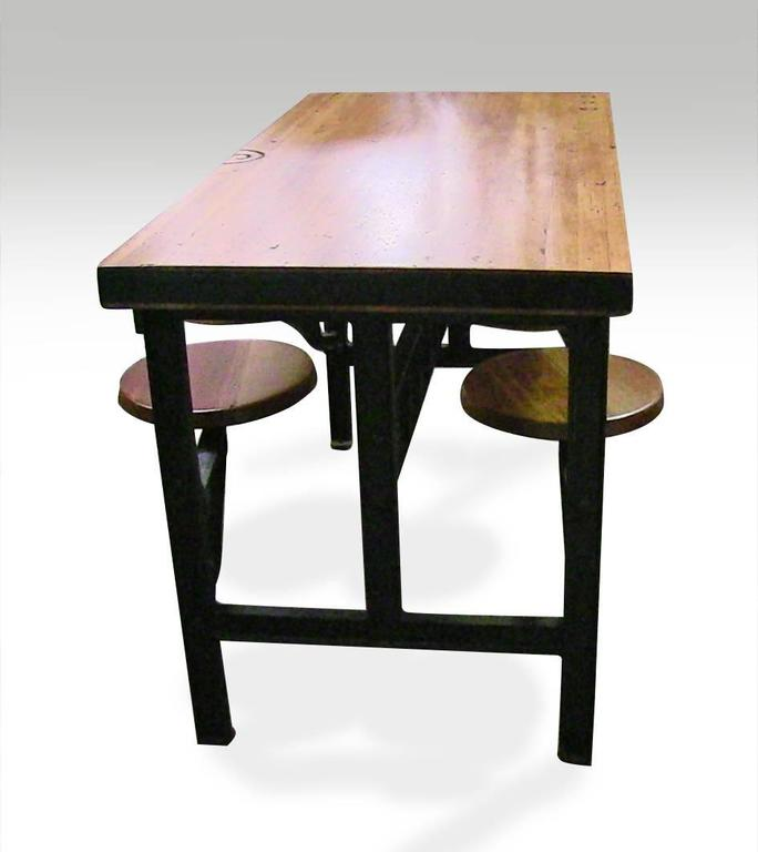 Cast Iron Swing Swivel Stool Industrial Factory Table with Four Stools For Sale 4