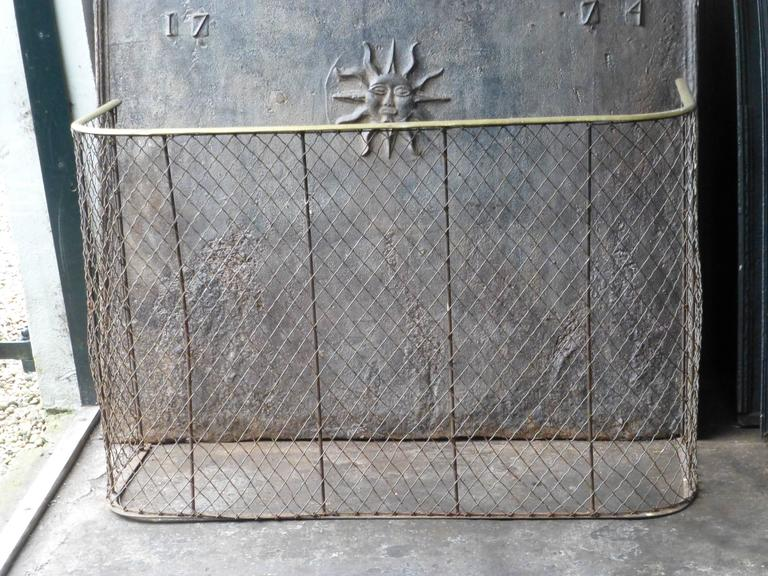 19th century English brass and iron fire guard.  We have a unique and specialized collection of antique and used fireplace accessories consisting of more than 1000 listings at 1stdibs. Amongst others we always have 300+ firebacks, 250+ pairs of