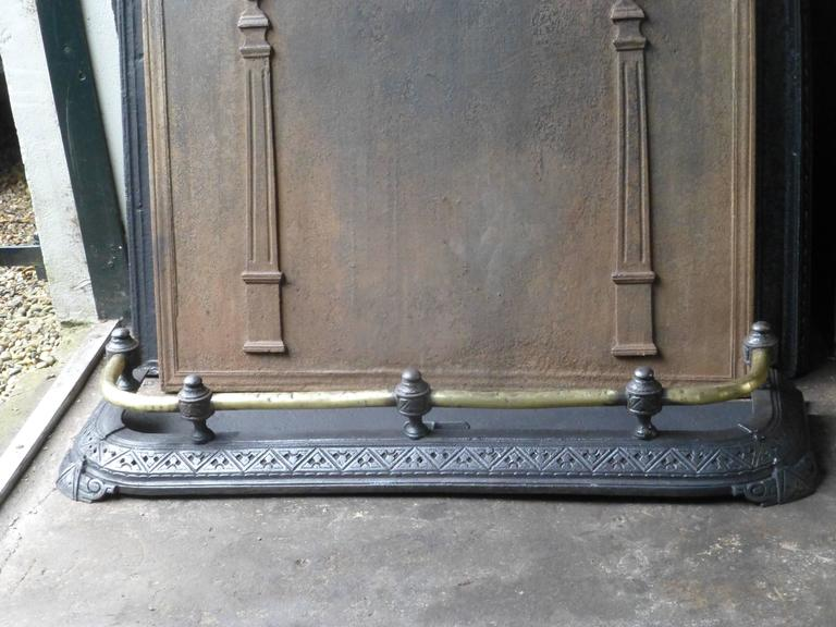 19th century English fire fender - fireplace screen made of brass and cast iron.