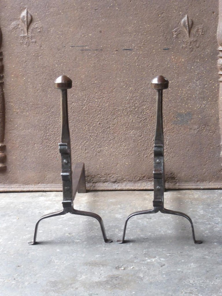 17th-18th century French Gothic andirons made of wrought iron. The andirons have spit hooks to grill food.