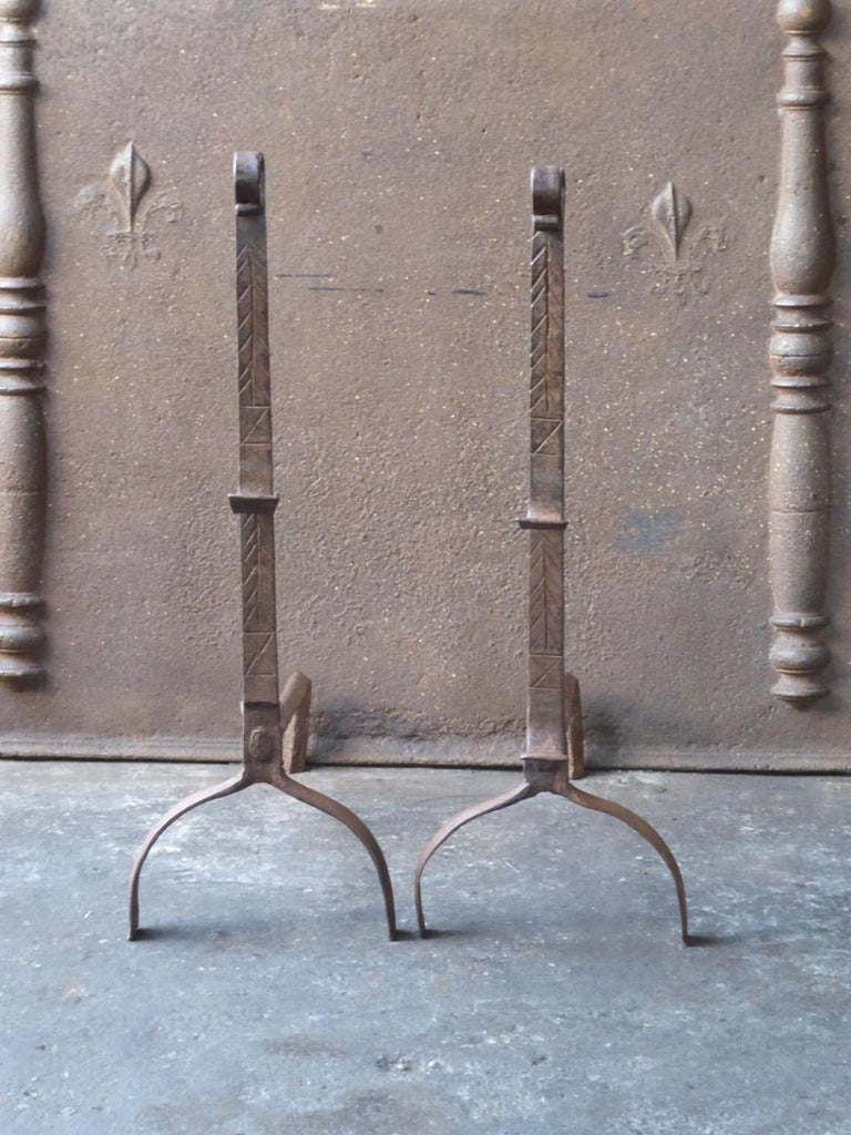 17th century French Gothic andirons. The andirons are beautifully forged and carved. They have spit hooks to grill food.