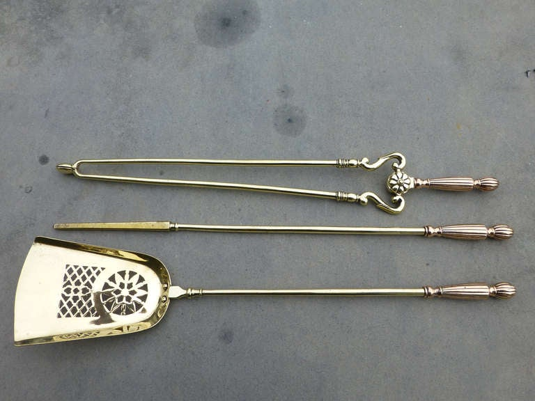 An impressive set of English fireplace tool set. Very fine quality and good weight.