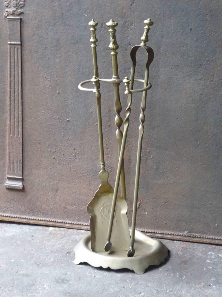 French brass fire irons made by Bouhon Frères. Bouhon Frères were prominent French producers of fireplace tools in the 19th century. The firm participated in the 1878 and 1900 Paris Expositions Universelles. French fire tools, fire irons made of