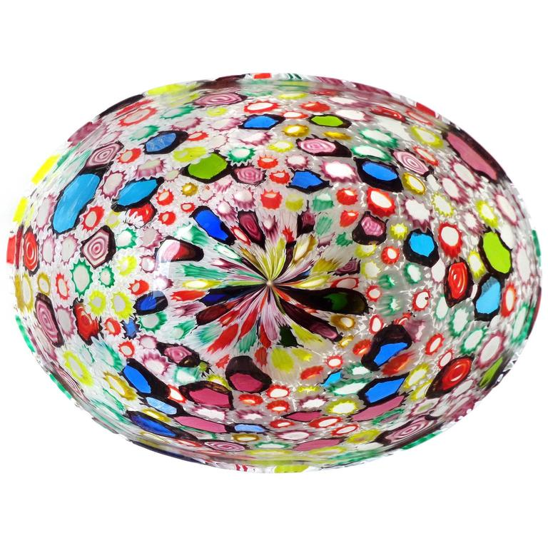 Incredible Murano hand blown multi color Millefiori flower and star mosaic Italian art glass oval bowl. Documented to the Fratelli Toso Company. Many of the murrines are lined in white, but some are lined in a metallic black. Measures 8 3/4