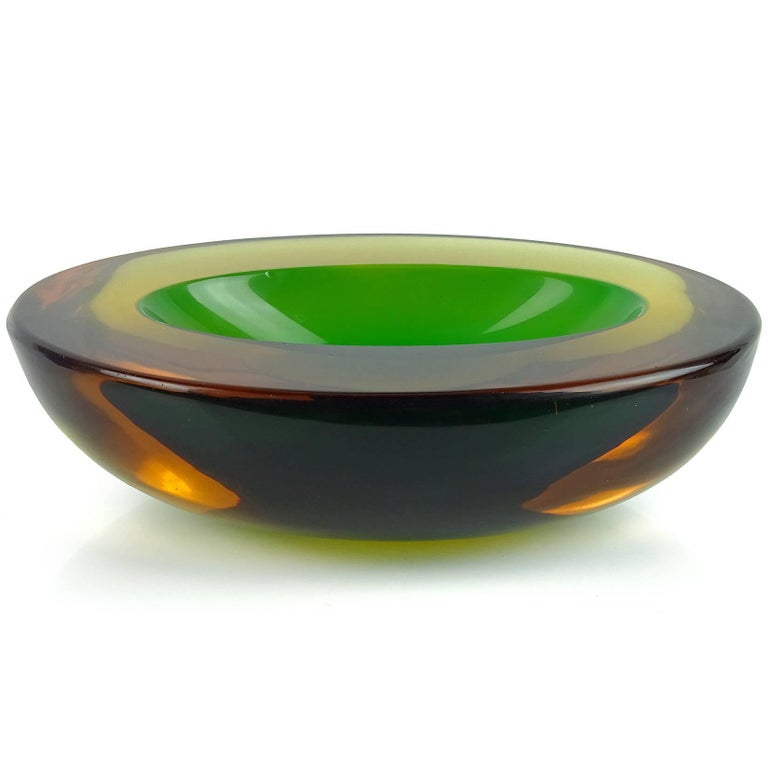 Beautiful Murano hand blown Sommerso yellow, orange amber and green Italian art glass bowl. Attributed to designer Flavio Poli, for the Seguso Vetri d'Arte company. The piece is very thick and heavy, with an oval shape and flat cut rim. Measures 7