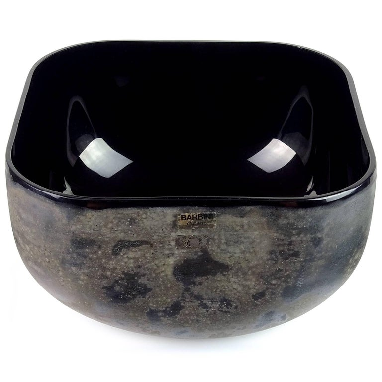 "Beautiful large Murano hand blown jet black Italian art glass centerpiece bowl with ""Scavo"" lava surface texture and slight iridescence. Documented, and fully signed by designer Alfredo Barbini, for Oggetti. It is also numbered. Measures 10 1/4"" x"
