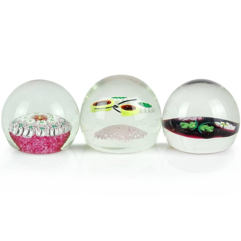 Priced Individually - Beautiful set of Murano handblown flower design Italian art glass paperweights. Documented to the Fratelli Toso Company. One has concentric rows of wild flowers, the second is a flower bouquet made with millefiori roses and