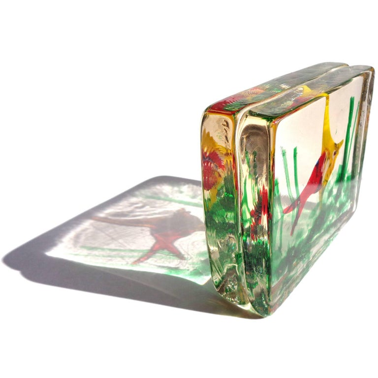 Beautiful Murano handblown bright red and yellow Italian art glass fish aquarium paperweight sculpture. In the manner of designer Alfredo Barbini and the Cenedese company. The piece is made with two layers of thick glass put together.
