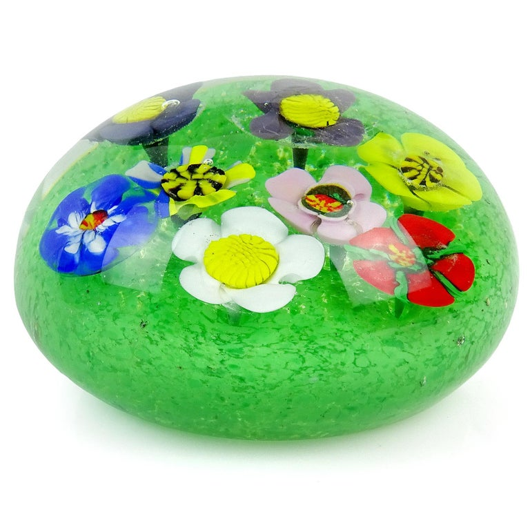 Gorgeous large Murano handblown millefiori wild flower garden Italian art glass paperweight. Each flower has a different color and pattern, and grow out of a green grass bed, made with little dots of color. Measures: 3 3/4