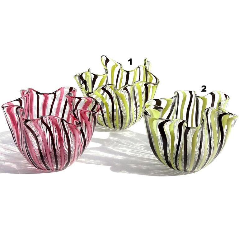 Beautiful Murano handblown Filigrana stripes Italian art glass mini decorative fazzoletto vases. Documented to designer Fulvio Bianconi, for the Venini company, circa 1950. Unusual color combinations, in yellow / black, and pink / black. One has a