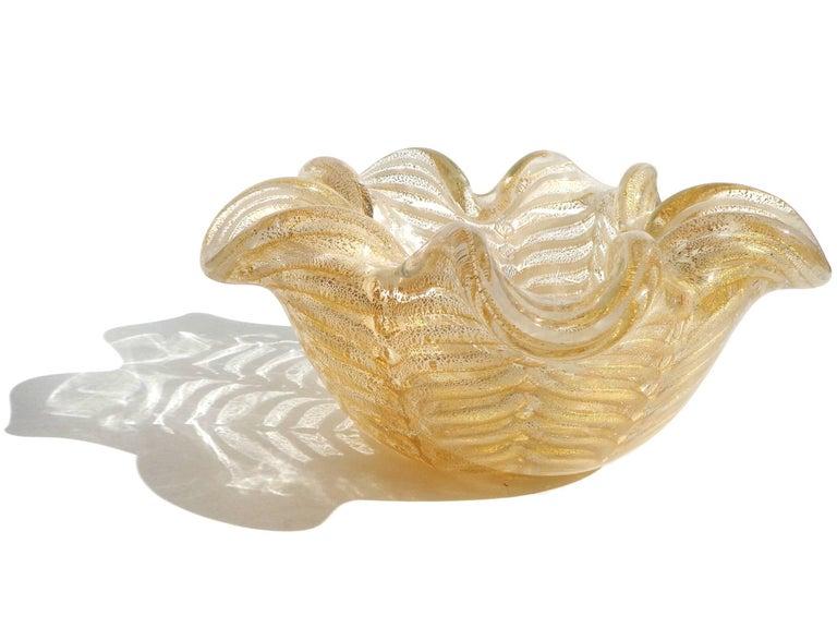 Priced per item - Beautiful Murano handblown gold flecks with white spiderweb design Italian art glass flower shaped bowls. Documented to designer Ercole Barovier for Barovier e Toso, circa 1960s. Created in the