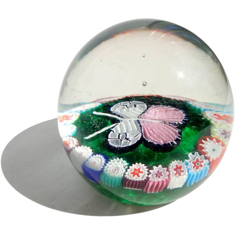 Rare and beautiful Murano handblown millefiori flowers and mosaic Italian art glass butterfly paperweight. Documented to the Fratelli Toso company. The butterfly has pink and white wings, with red, blue, green, orange, white and purple flowers