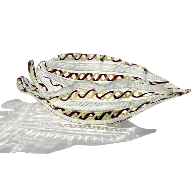 Gorgeous Murano handblown white, yellow and purple twisted ribbons art glass leaf shaped bowl. Created in the manner of the Venini and Aureliano Toso companies. Measures 8