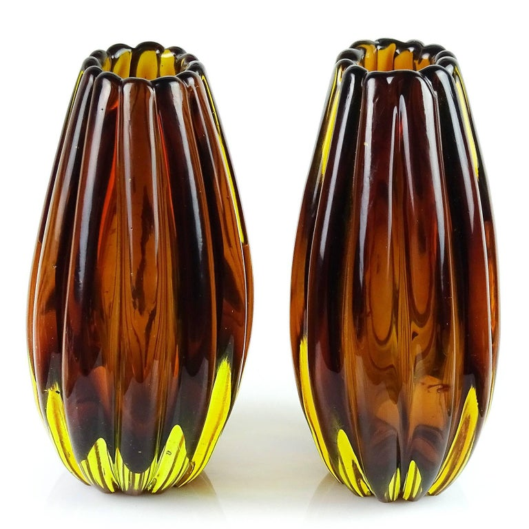 """Beautiful pair of Murano handblown Sommerso blown and yellow Italian art glass flower vases. Documented to designer Flavio Poli for Seguso Vetri D' Arte, model number 12024, circa 1958. They measure 7 1/4"""" and 7"""