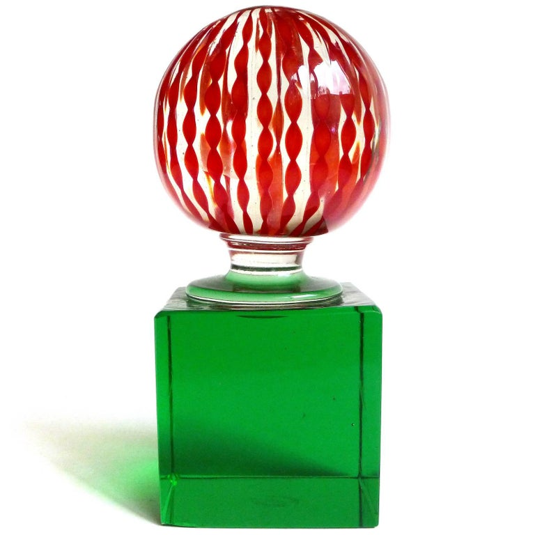 Murano handblown red twisted ribbons on green base Italian art glass paperweight. Documented to Paolo Venini, and signed underneath