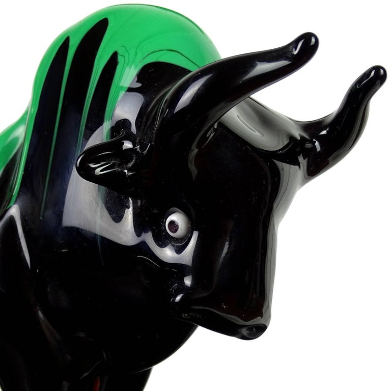 Beautiful large Murano hand blown, jet black with green drips Italian art glass Taurus bull sculpture. Has a red Murano label on the base. Measures 10