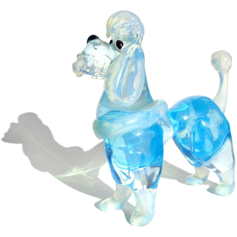 Very cute Murano hand blown pink and blue Italian art glass opalescent poodle dog figurines. Attributed to the Barovier e Toso company, circa 1960s. The pink dog is a little larger than the blue one. Both pups are very well sculpted.