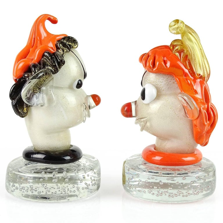 Priced per item, beautiful and cute Murano handblown orange, black, white and gold flecks Italian art glass elf head paperweights. Documented to designer Alfredo Barbini. One with original Barbini label. Very expressive little guys, with hats and