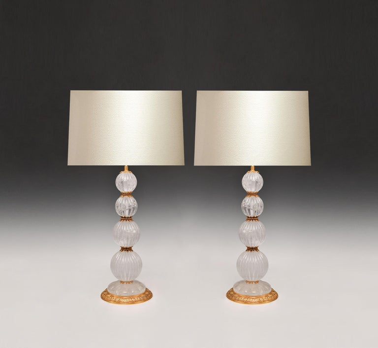 Pair of Fine carved globes ormolu-mounted rock crystal lamps.  To the top of rack crystal: 19