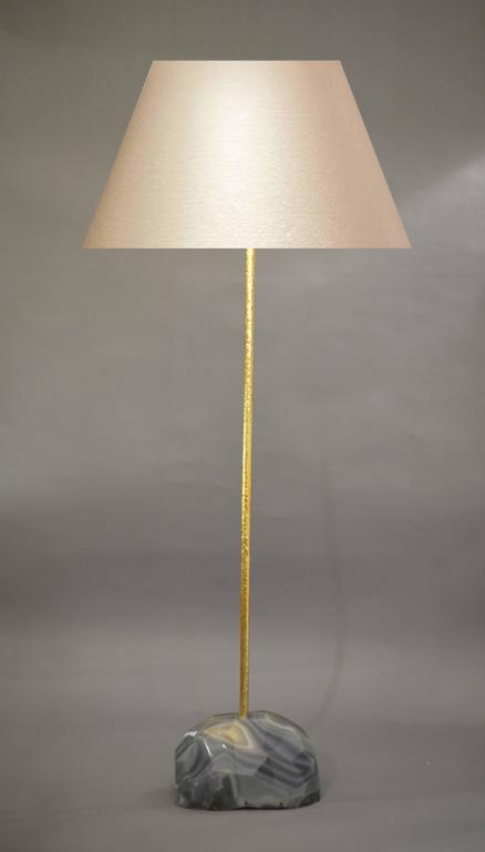 A fine carved geometric form agate floor lamp with repousse pole, designed by Jian C. (Lampshade not included).
