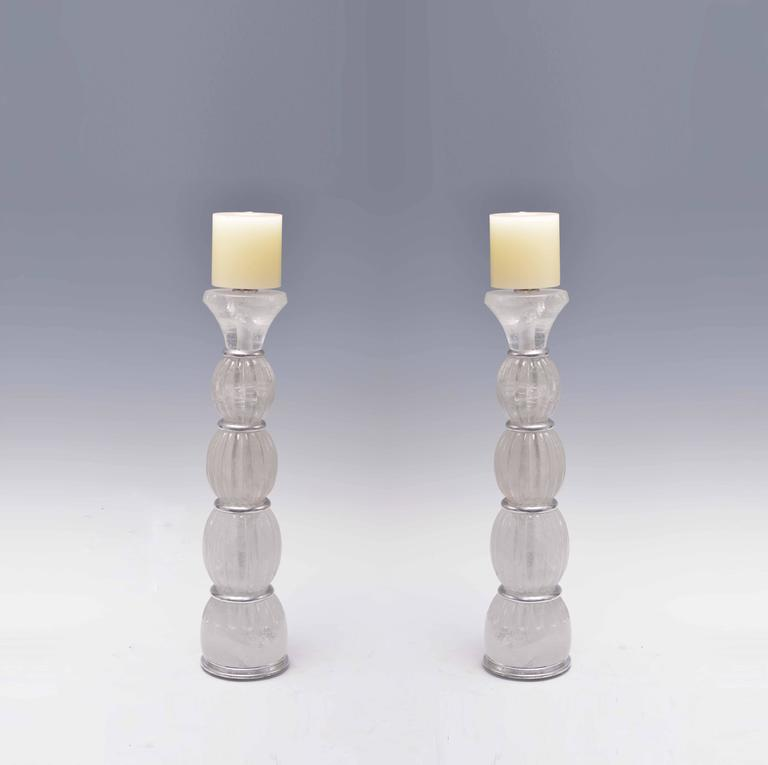 A pair of fine carved ribbed rock crystal quartz candle holders.