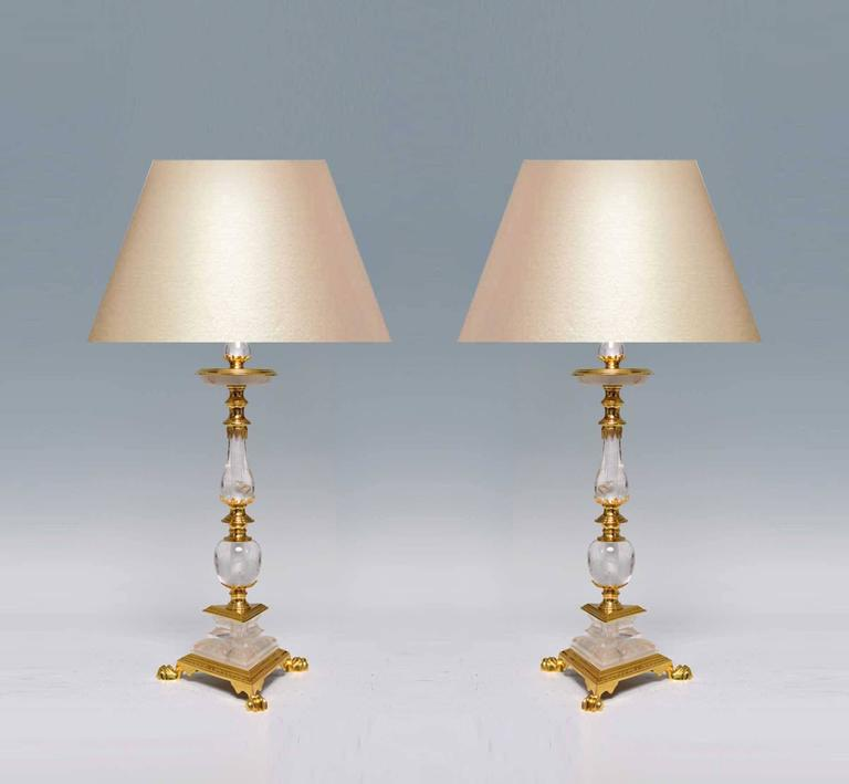 Fine cast polish bronze with finely carved rock crystal ormolu-mounted lamps, created by Phoenix Gallery, NYC. To the rock crystal: 20