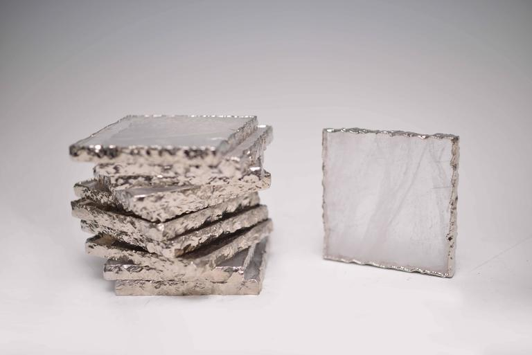 A square form clear rock crystal quartz coaster with nickel plating decoration,created by Phoenix Gallery.