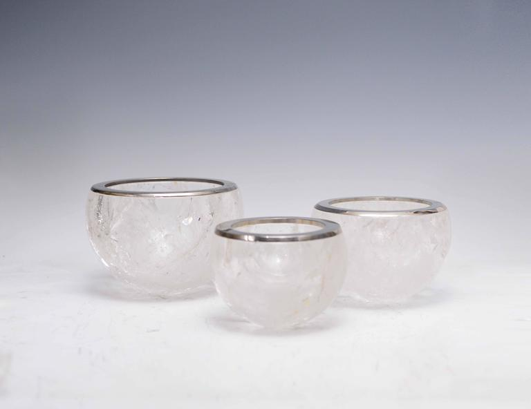 Finely carved rock crystal bowls with nickel plating rim.  Dimension: (from left to right) 5.75