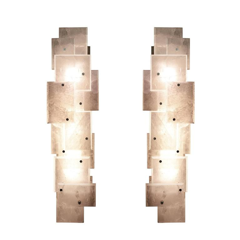 A pair of modern rock crystal quartz sconces with rock crystal panel decorations, created by Phoenix Gallery. Each sconce has two sockets, use LED, long tube, warm lights. Four 100 watts LED, warm lights are included.  For more rock crystal