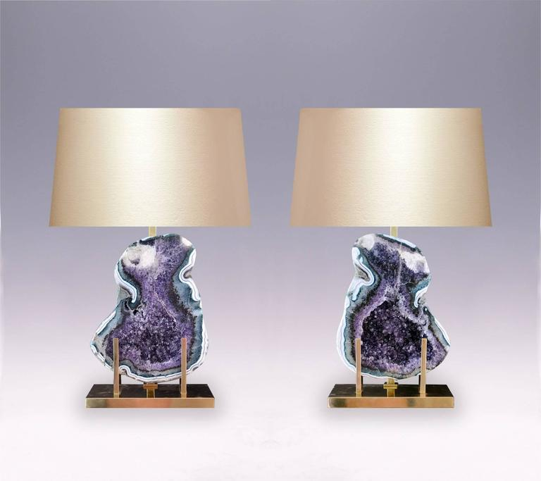 A pair of natural amethyst rock crystal lamps with amazing colorful amethyst stones, with polished brass mount, created by Phoenix Gallery, NYC. (Lampshade not included).  For more Rock Crystal lightings and accessories from Phoenix gallery, please
